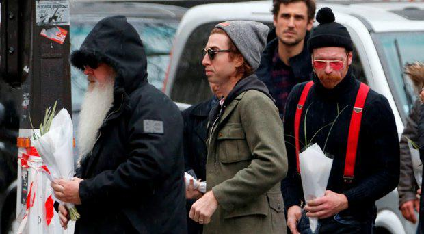 Dave Catching (L), Julian Dorio (C) and Jesse Hughes (R), members of Eagles of Death Metal band, arrive at the Bataclan concert hall to pay tribute to the shooting victims in Paris, France, December 8, 2015
