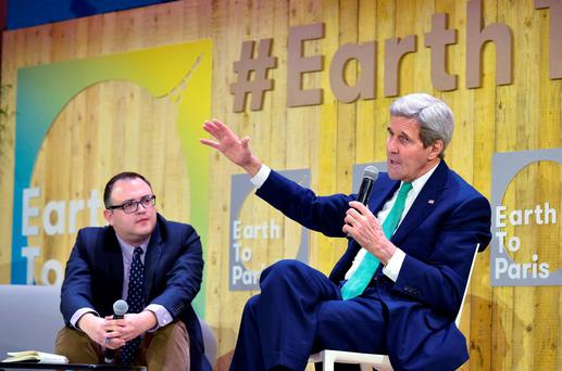 US Secretary of State John Kerry, right, gestures as he speaks, flanked by Mashable science editor Andrew Freedman, at the Mashable/UN Foundation