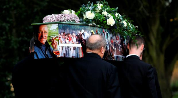 Pat Eddery's coffin is carried into the church before his funeral service yesterday