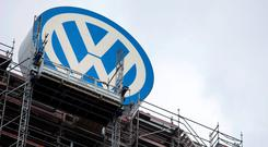 The Volkswagen logo sits atop the company's headquarters in Wolfsburg.