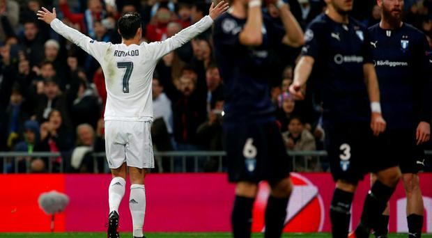 Football Soccer - Real Madrid v Malmo - Champions League Group Stage - Group A - Santiago Bernabeu, Madrid, Spain - 8/12/15 Real Madrid's Cristiano Ronaldo celebrates after scoring the third goal. REUTERS/Juan Medina