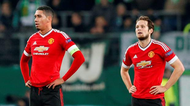 Manchester United's Bastian Schweinsteiger and Chris Smalling look dejected against Wolfsburg