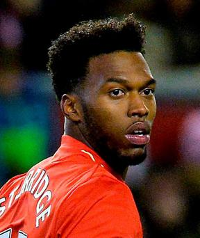Liverpool's Daniel Sturridge may be out until the New Year with injury