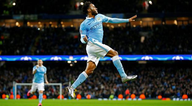 Raheem Sterling celebrates after scoring the third goal for Manchester City