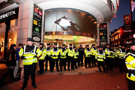 Anti-austerity protests forced gardaí to place a ring of steel around the St Stephen's Green Shopping Centre after some activists occupied prominent shops including Brown Thomas. Photo: Stephen Collins