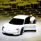 Porsche's Mission E is a fully electric four-seater with a 300-mile range.