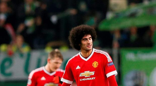 Manchester United's Marouane Fellaini looks dejected against Wolfsburg.