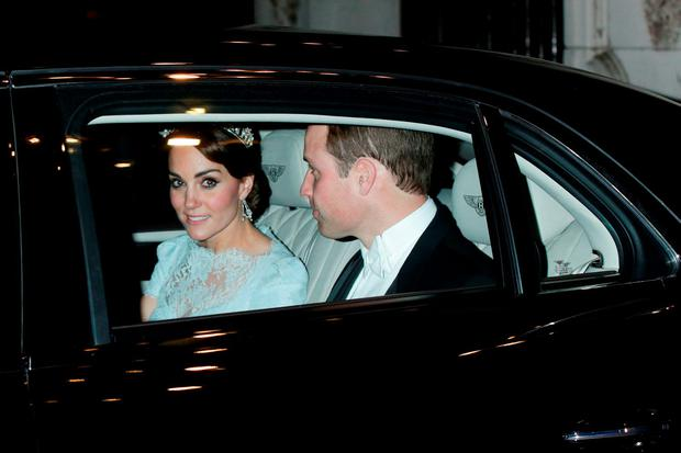 The Duchess of Cambridge leaves a diplomatic reception at Buckingham Palace, wearing one of the