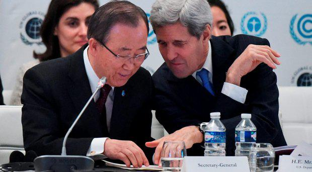 US Secretary of State John Kerry, right, talks with United Nations Secretary General Ban Ki-moon during the Caring for Climate Business Forum event as part of the COP 21 United Nations conference on climate change