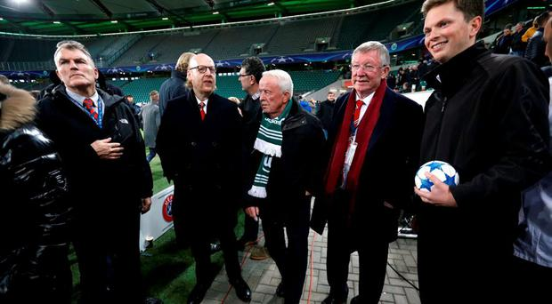 Alex Ferguson and Manchester United co owner Avram Glazer pitchside after being held in the stadium after the game due to a security alert last night Action Images via Reuters / Carl Recine