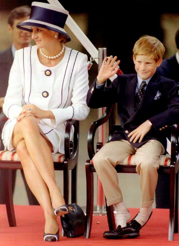 Princess Diana(L) and her son Harry(R) watch veterans as they march past a dais on the Mall as part of the commemorations of VJ Day 19 August.