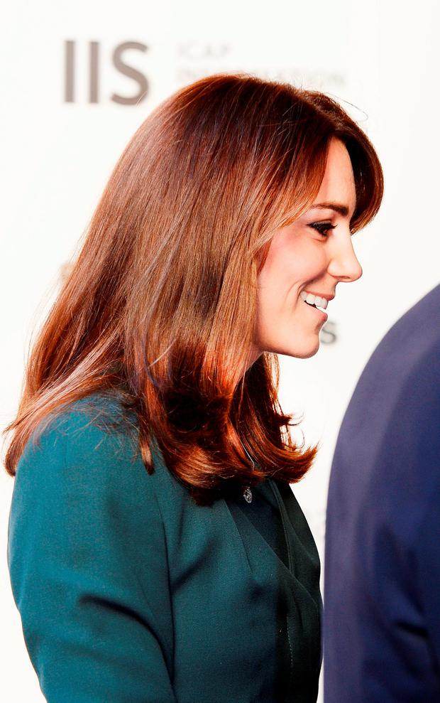 The Duchess of Cambridge arrives with her husband, the Duke of Cambridge, at ICAP's London office for the firm's 23rd annual charity day