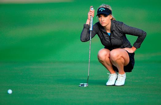 Paige Spiranac of United States lines up a par putt at the par 5, 10th hole during the first round of the 2015 Omega Dubai Ladies Masters on the Majlis Course at The Emirates Golf Club on December 9, 2015 in Dubai, United Arab Emirates. (Photo by David Cannon/Getty Images)