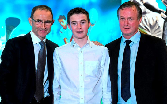 Fourteen year old Donal O'Shea, representing his dad, the former Tipperary senior hurling manager Eamon O'Shea, who was manager of the month for July, with Republic of Ireland manager Martin O'Neill, left, and Northern Ireland manager Michael O'Neill, who were jointly presented with the Philips Manager of the Year Award. Philips Manager of the Year 2015 Picture credit: Ray McManus / SPORTSFILE