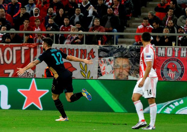 Arsenal's Olivier Giroud celebrates after scoring against Olympiakos at the Georgios Karaiskakis stadium