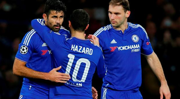 Diego Costa celebrates with team mates after Ivan Marcano scored an own goal for Chelsea's first goal