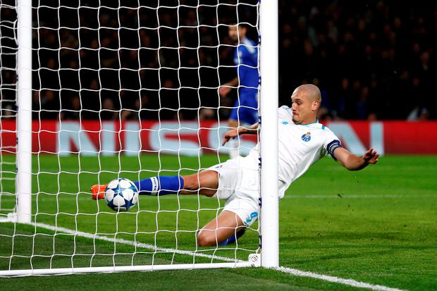 Maicon attempts to clear a deflection from Ivan Marcano as he scores an own goal for Chelsea's first goal