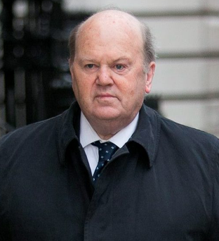 Finance Minister Michael Noonan announced the introduction of lower fees for shops processing debit and credit cards