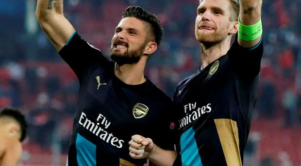 Arsenal's scorer Olivier Giroud and Per Mertesacker wave to their fans