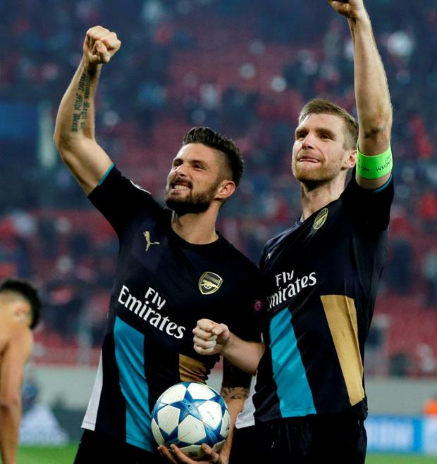Arsenal's scorer Olivier Giroud, left, Per Mertesacker wave to their fans