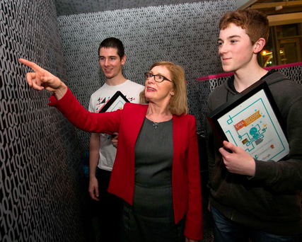 Nebojsa Cvetkovic (18), left, from The High School, Rathgar, and Caolan Fleming (14), from St Mary's CBS, Portlaoise, with Education Minister Jan O'Sullivan
