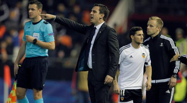 Valencia coach Gary Neville getures on the sidelines during the Champions League clash with Lyon at the Mestalla stadium