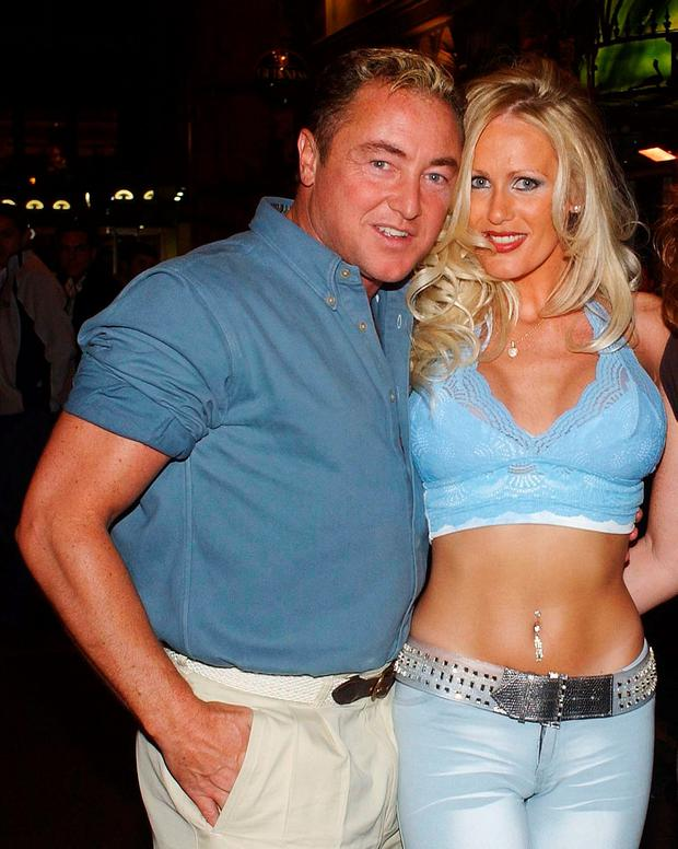'Lord of the Dance' star Michael Flatley poses with ex fiancée Lisa Murphy June 29, 2002