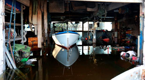 Domnick Lynch's seaboat floats on the floodwaters in his shed at Carrowkeel Co Sligo . Picture Credit Frank Mc Grath 9/12/15