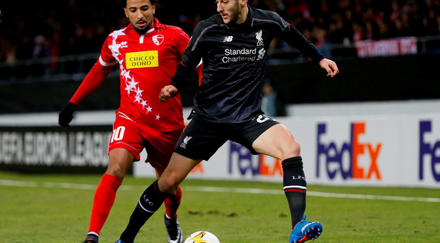 Liverpool's Adam Lallana and FC Sion's Carlitos. Action Images via Reuters / Lee Smith