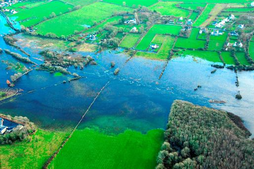 Air Corps handout photo of the river Suck at Ballinasloe after Storm Desmond hit the area over the weekend. story WEATHER Floods Ireland. Photo: Airman Jamie Martin/Air Corps/PA Wire.