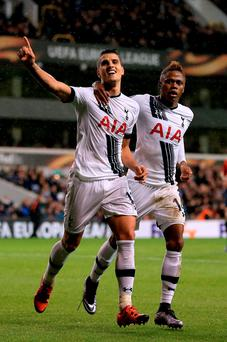 Tottenham Hotspur's Erik Lamela (left) celebrates scoring his side's third goal and completing his hat-trick. Nick Potts/PA Wire.
