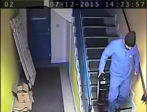 One of the two thieves leaves the wholesaler's premises with a security box containing around €60,000