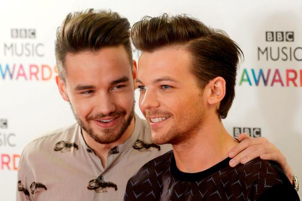 Louis Tomlinson (pictured with Liam Payne) has become a father for the first time. Photo: Joe Giddens/PA Wire