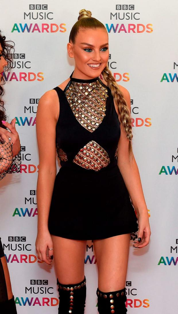 Perrie Edwards of Little Mix arrives on the red carpet for the BBC Music Awards at the Genting Arena, Picture: Joe Giddens/PA Wire