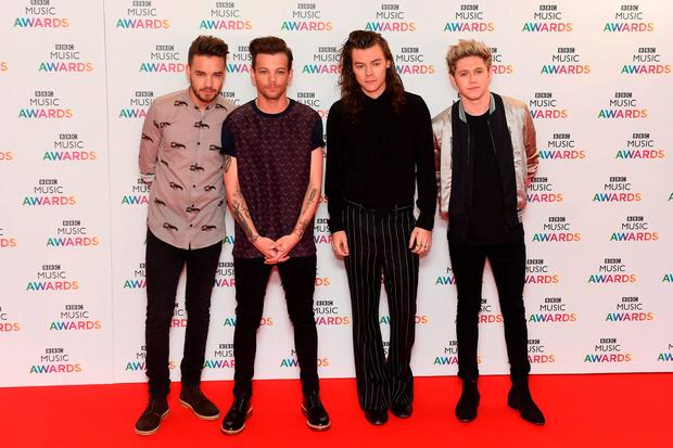(left to right) Liam Payne, Louis Tomlinson, Harry Styles and Niall Horan of One Direction arrives on the red carpet for the BBC Music Awards at the Genting Arena, Birmingham. Picture: Joe Giddens/PA Wire