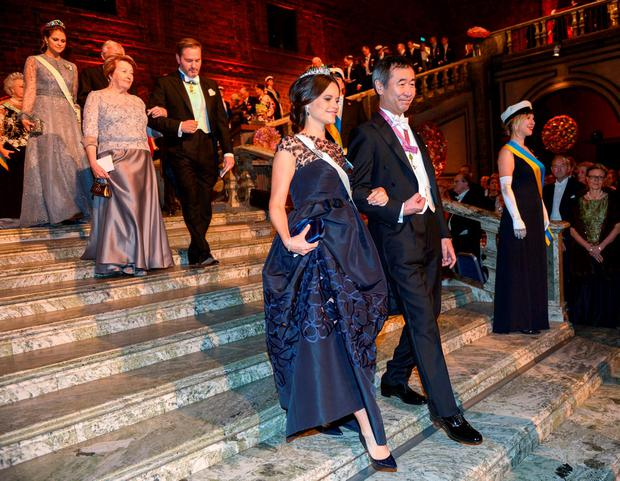 Princess Sofia and physics laureate Takaaki Kajita arrive in the Blue Hall for the 2015 Nobel prize award banquet in Stockholm City Hall