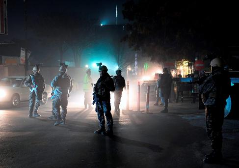 Afghan Crisis Response Unit stand guard at the site of bomb attack on the Spanish embassy compound in Kabu Credit: Wakil Kohsar (AFP/Getty Images)