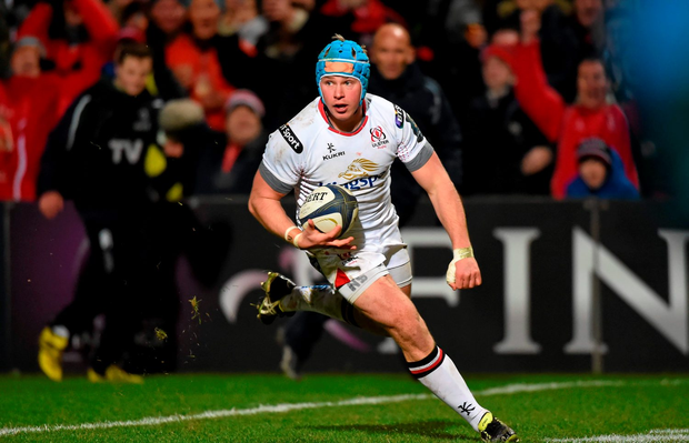 Luke Marshall on his way to scoring Ulster's third try