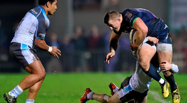 Connacht's Peter Robb is tackled by Newcastle duo Dan Marshall and Tane Takulua