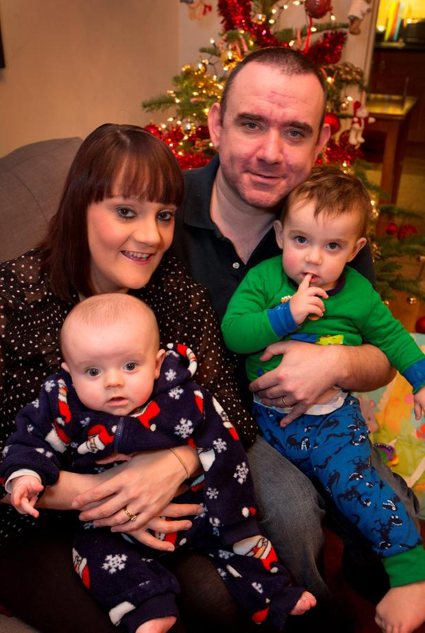 Denis Forde pictured with his family, Nina and their children Jack (1 and a half) and Owen (5 mths) at their Crumlin home ast night. SEE FIONA DILLON COPY