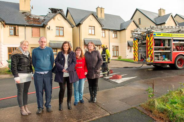 Provision 111215 Kevin and Susanne Cashman (centre) with neighbours in front of The house in Kanturk from which the Cashman family were saved from fire. Pic Michael Mac Sweeney/Provision