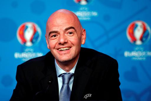 UEFA General Secretary Gianni Infantino is all smiles at UEFA's executive committee in Paris yesterday