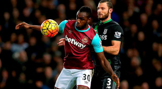 West Ham United's Michail Antonio (left) and Stoke City's Erik Pieters battle for the ball during the Barclays Premier League match at Upton Park