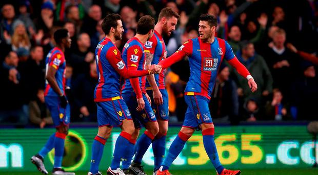 Yohan Cabaye (2nd L) of Crystal Palace celebrates scoring his team's first goal with his team mates during the Barclays Premier League match between Crystal Palace and Southampton at Selhurst Park