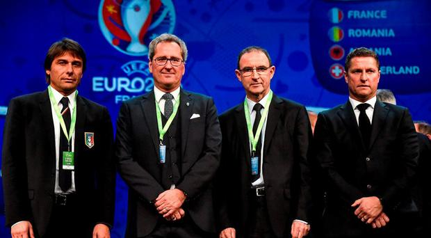 Republic of Ireland manager Martin O'Neill, centre right, with fellow Group E managers, from left, Antonio Conte, Italy, Erik Hamren, Sweden, and Marc Wilmots, Belgium, after the UEFA EURO Final Tournament Draw. Le Palais des Congrès de Paris, Paris, France. Picture credit: David Maher / SPORTSFILE