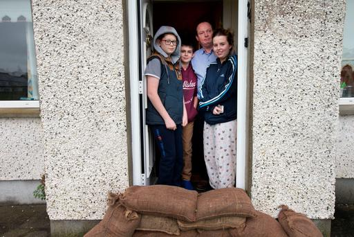 Sand bags in place to prevent flood waters from the River Shannon encroach the house of Kevin O'Connor and his children Tristin, Oisin and Amy in the Portavolla estate at Bannaher, Co. Offally. Photo: Tony Gavin