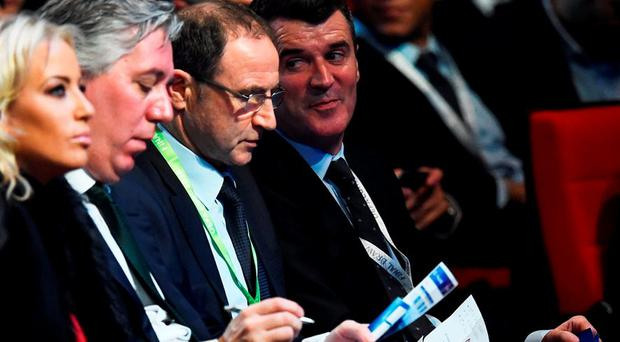 Martin O'Neill (2nd R) and Roy Keane (1st R) react after Italy is drawn into Group E during the UEFA Euro 2016 Final Draw Ceremony at Palais des Congres in Paris. (Photo by Laurence Griffiths/Getty Images)