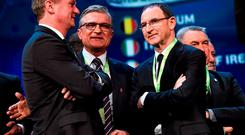 Republic of Ireland manager Martin O'Neill, right, with Northern Ireland manager Michael O'Neill, left, and Poland manager Adam Nawalka, at the end of the UEFA EURO Final Tournament Draw
