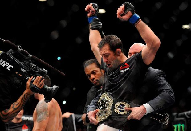 Luke Rockhold is declared the winner and wins the championship against Chris Weidman during UFC 194 at MGM Grand Garden Arena. Credit: Gary A. Vasquez-USA TODAY Sports