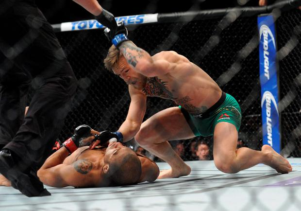 Conor McGregor lands punches to win b technical knockout against Jose Aldo during UFC 194 at MGM Grand Garden Arena. Credit: Gary A. Vasquez-USA TODAY Sports
